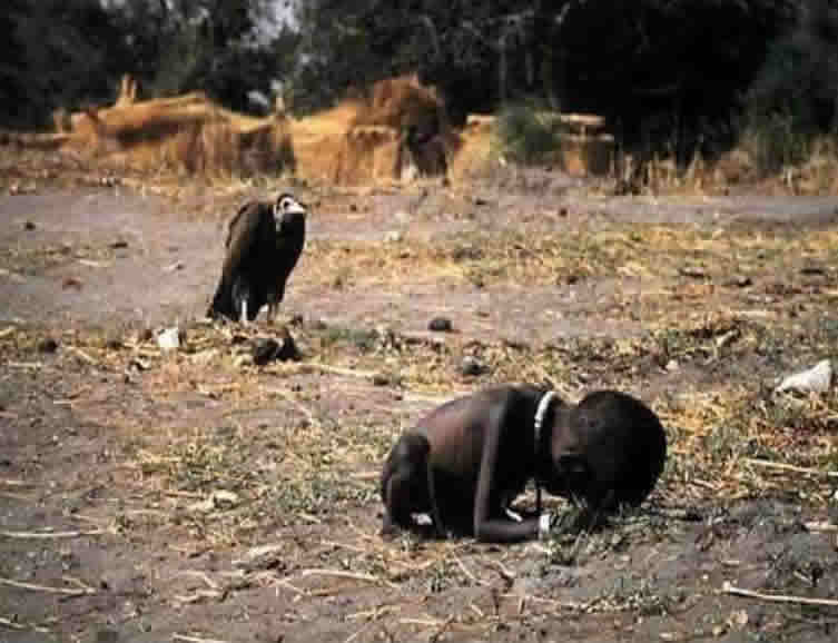 This photograph showing a starving Sudanese child being stalked by a ...